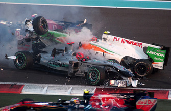 Michael Schumacher, Mercedes GP MGP W01 spins and collects Vitantonio Liuzzi, Force India VJM03