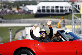 Fernando Alonso, McLaren, waves to the fans