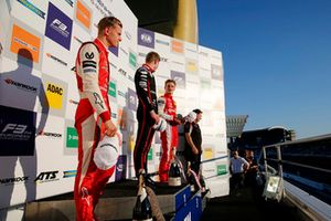 Podium: Race winner Jüri Vips, Motopark Dallara F317 - Volkswagen, Champion Mick Schumacher, PREMA Theodore Racing Dallara F317 - Mercedes-Benz, third place Ralf Aron, PREMA Theodore Racing Dallara F317 - Mercedes-Benz