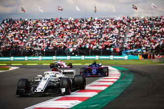 Marcus Ericsson, Sauber C37, leads Brendon Hartley, Toro Rosso STR13, and Esteban Ocon, Racing Point Force India VJM11