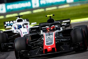Kevin Magnussen, Haas F1 Team VF-18, leads Lance Stroll, Williams FW41