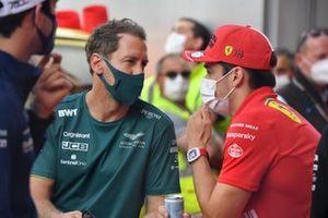 Sebastian Vettel, Aston Martin, and Charles Leclerc, Ferrari, in the drivers parade