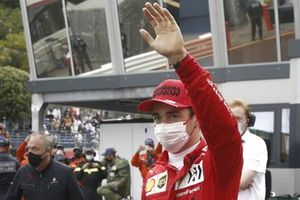 Pole man Charles Leclerc, Ferrari, waves to fans from Parc Ferme