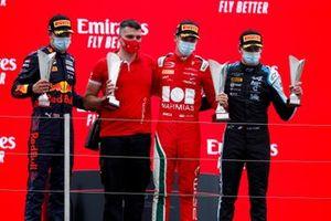 Dennis Hauger, Prema Racing, 2nd position, the Prema team representative, Arthur Leclerc, Prema Racing, 1st position, and Victor Martins, MP Motorsport, 3rd position, on the podium
