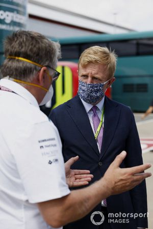 Otmar Szafnauer, Team Principal and CEO, Aston Martin F1, and Aston Martin team members talk with Oliver Dowden CBE, Secretary of State for Digital, Culture, Media and Sport