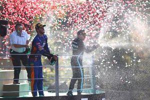 Daniel Ricciardo, McLaren, 1st position, and Valtteri Bottas, Mercedes, 3rd position, spray Champagne on the podium