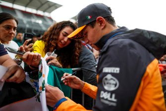 Lando Norris, McLaren signs an autograph for a fan