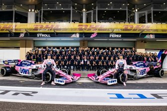 Sergio Perez, Racing Point, and Lance Stroll, Racing Point pose, for a group photo with the 2019 team