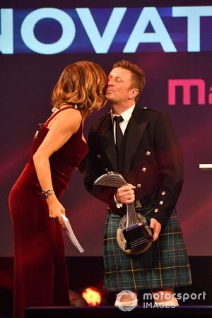 Allan McNish on stage with Natalie Pinkham, Sky TV, to present the Pioneering and Innovation Award
