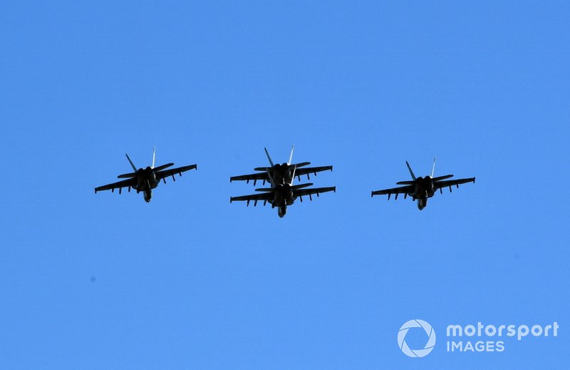 A quartet of US Navy F/A-18E Super Hornets fly over the grid prior to the start