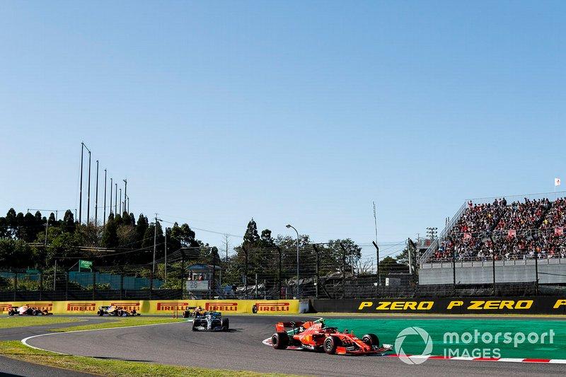 Charles Leclerc, Ferrari SF90, leads Lewis Hamilton, Mercedes AMG F1 W10, Carlos Sainz Jr., McLaren MCL34, and Lando Norris, McLaren MCL34