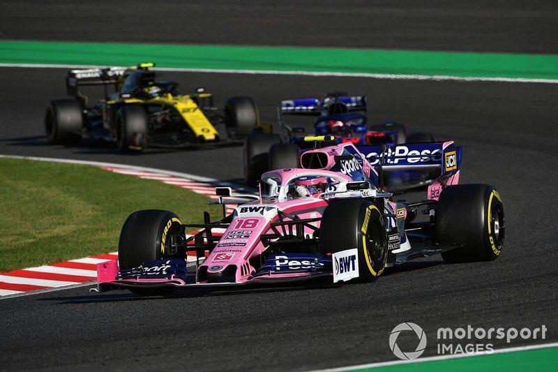 Lance Stroll, Racing Point RP19, leads Daniil Kvyat, Toro Rosso STR14, and Nico Hulkenberg, Renault F1 Team R.S. 19