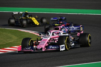 Lance Stroll, Racing Point RP19, leads Daniil Kvyat, Toro Rosso STR14, and Nico Hulkenberg, Renault F1 Team R.S. 19