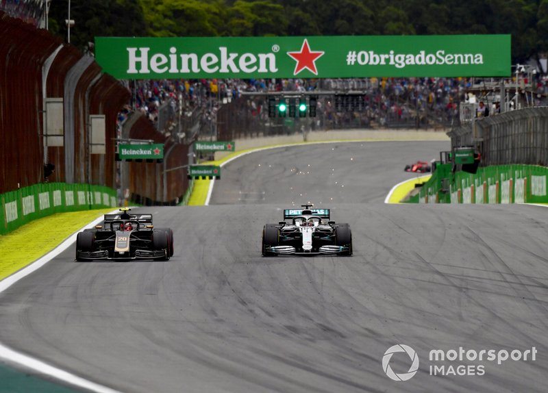 Lewis Hamilton, Mercedes AMG F1 W10, passes Kevin Magnussen, Haas F1 Team VF-19