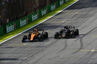 Lando Norris, McLaren MCL34, passes Romain Grosjean, Haas F1 Team VF-19