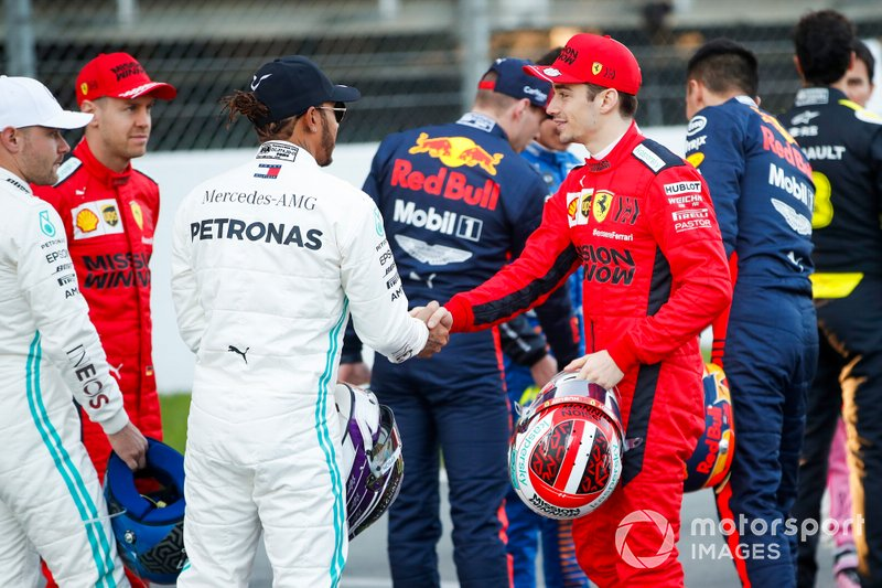 Lewis Hamilton, Mercedes-AMG Petronas F1, shakes hands with Charles Leclerc, Ferrari