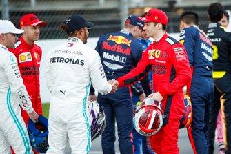 Lewis Hamilton, Mercedes-AMG Petronas F1, shakes hands with Charles Leclerc, Ferrari