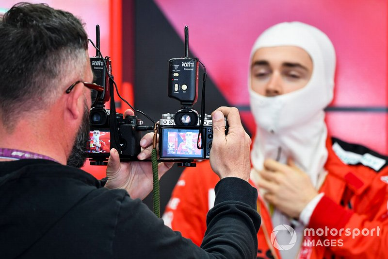 Cameraman in the Ferrari garage with Charles Leclerc, Ferrari