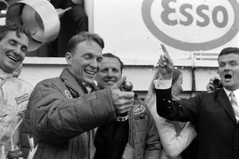 Dan Gurney, A.J. Foyt celebrate their victory