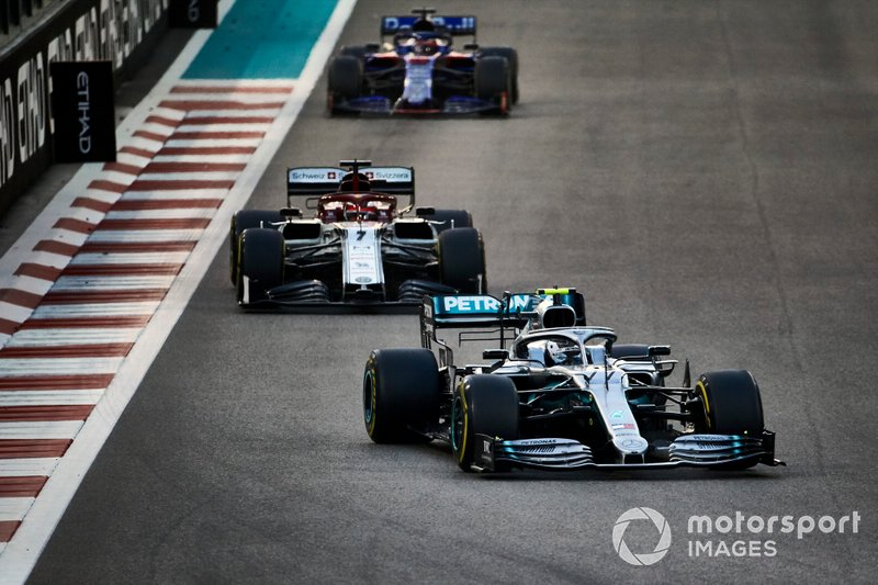 Valtteri Bottas, Mercedes AMG W10, leads Kimi Raikkonen, Alfa Romeo Racing C38, and Daniil Kvyat, Toro Rosso STR14