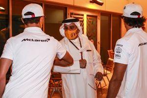 Lando Norris, McLaren, bumps elbows with Crown Prince Salman bin Hamad bin Isa Al Khalifa as Carlos Sainz Jr., McLaren, looks on