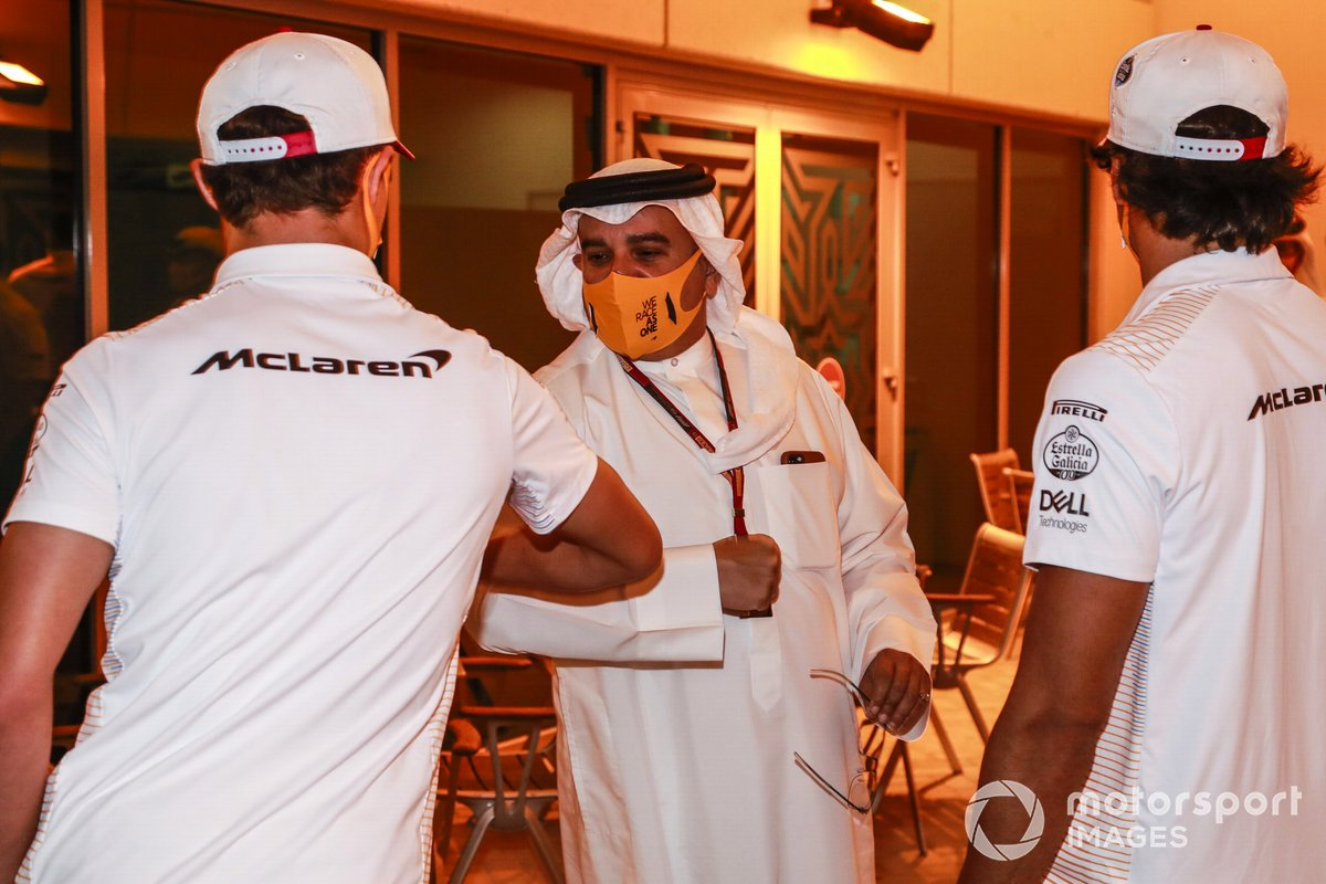 Lando Norris, McLaren, bumps elbows with Crown Prince Salman bin Hamad bin Isa Al Khalifa as Carlos Sainz Jr., McLaren, looks on