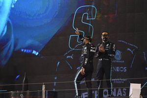 Valtteri Bottas, Mercedes, 3rd position, applauds as Lewis Hamilton, Mercedes, 1st position, arrives on the podium