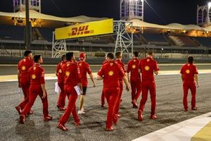 Sebastian Vettel, Ferrari, walks the track with members of his Ferrari team