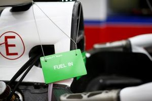 Maintenance sign denoting that a car is fuelled in the Haas F1 garage