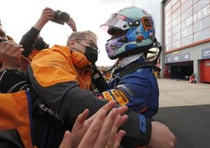 Daniel Ricciardo, McLaren, celebrates with his team in Parc Ferme