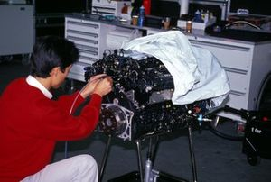 A Honda engineer works on one of the engines that powers the McLaren MP4-6