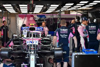 Lance Stroll, Racing Point, and Racing Point mechanics in the garage