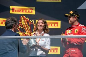 The Constructors Trophy is presented to the Mercedes delegate on the podium