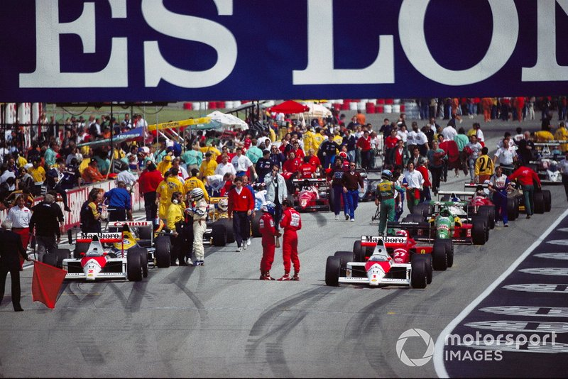 Alain Prost e Ayrton Senna, McLaren conversam no grid antes da relargada