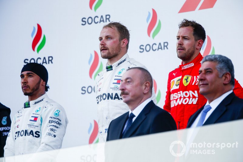 Lewis Hamilton, Mercedes AMG F1, 2nd position, Valtteri Bottas, Mercedes AMG F1, 1st position, Sebastian Vettel, Ferrari, 3rd position, and the trophy delegates on the podium