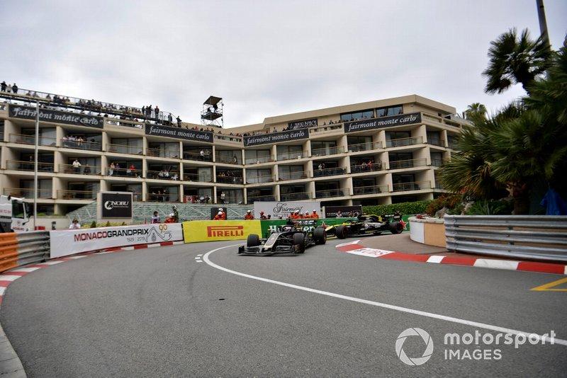 Romain Grosjean, Haas F1 Team VF-19, leads Daniel Ricciardo, Renault R.S.19