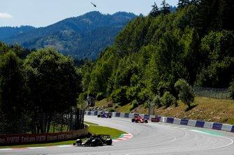 Romain Grosjean, Haas F1 Team VF-19, leads Sebastian Vettel, Ferrari SF90