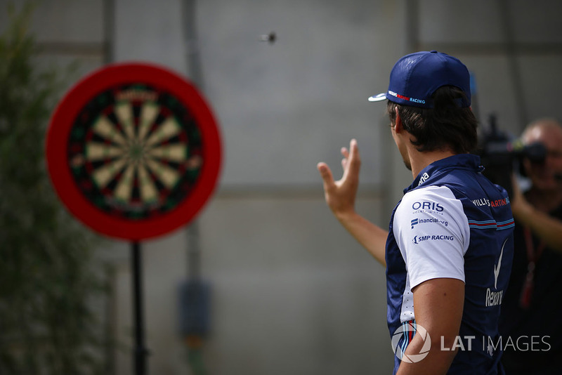 Lance Stroll, Williams Racing, plays darts