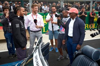 Jenson Button interviews Lewis Hamilton, Mercedes AMG F1, and his dad Anthony Hamilton