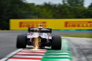 Sparks fly from the rear of Daniil Kvyat, Toro Rosso STR14