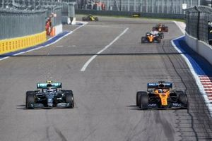 Valtteri Bottas, Mercedes AMG W10, battles with Carlos Sainz Jr., McLaren MCL34