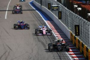 Kevin Magnussen, Haas F1 Team VF-19, leads Lance Stroll, Racing Point RP19, and Pierre Gasly, Toro Rosso STR14
