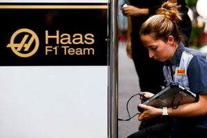 A Pirelli technician works with the Haas F1 team