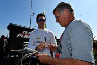 Simon Pagenaud, Team Penske Chevrolet signs an autograph for fans