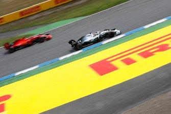 Lewis Hamilton, Mercedes AMG F1 W10, passes Sebastian Vettel, Ferrari SF90