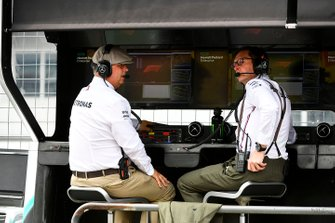Old fashioned dress adorns Ron Meadows, Sporting Director, Mercedes AMG, and Andrew Shovlin, Chief Race Engineer, Mercedes AMG, on the Mercedes pit wall