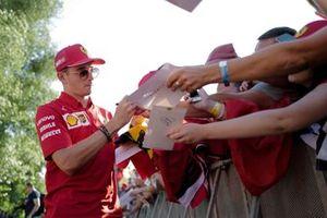 Charles Leclerc, Ferrari signs an autograph for a fan