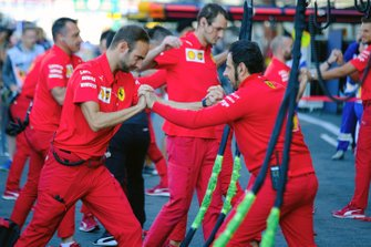 Ferrari team members gymnastics