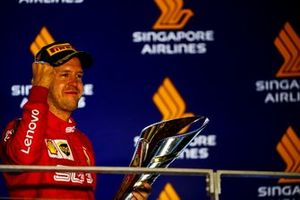 Race winner Sebastian Vettel, Ferrari celebrates n the podium with the trophy
