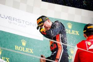 Race winner Juri Vips, Hitech Grand Prix celebrates on the podium with the champagne